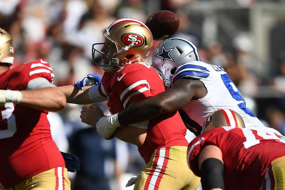 C.J. Beathard #3 of the San Francisco 49ers is stripped of the ball by DeMarcus Lawrence #90 of the Dallas Cowboys during their NFL game at Levi's Stadium on October 22, 2017 in Santa Clara, California. Photo: Thearon W. Henderson, Getty Images