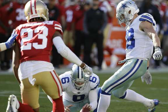 Dallas Cowboys strong safety Jeff Heath (38) kicks a point after try during the second half of an NFL football game against the San Francisco 49ers in Santa Clara, Calif., Sunday, Oct. 22, 2017. (AP Photo/Eric Risberg)