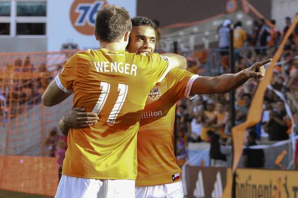 Houston Dynamo forward Andrew Wenger (11) hugs  Mauro Manotas (19) after Manotas scored a goal during the second half of the last MLS regular game at BBVA Compass Stadiujm on Sunday, Oct. 22, 2017, in Houston. The Houston Dynamo defeated the Chicago Fire 3-0. ( Yi-Chin Lee / Houston Chronicle )