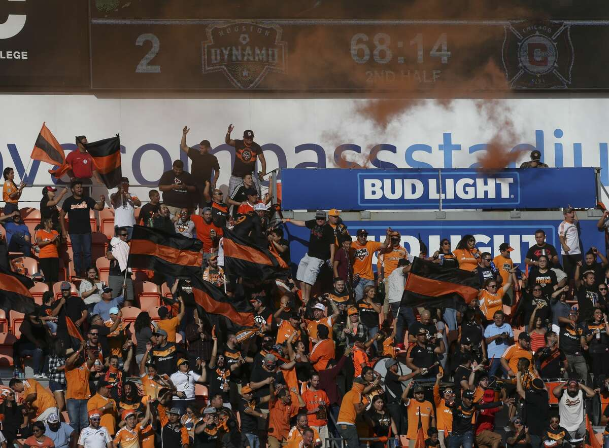 Houston Dynamo fans celebrate Houston Dynamo forward Romell Quioto's goal during the second half of the last MLS regular game at BBVA Compass Stadiujm on Sunday, Oct. 22, 2017, in Houston. The Houston Dynamo defeated the Chicago Fire 3-0. ( Yi-Chin Lee / Houston Chronicle )