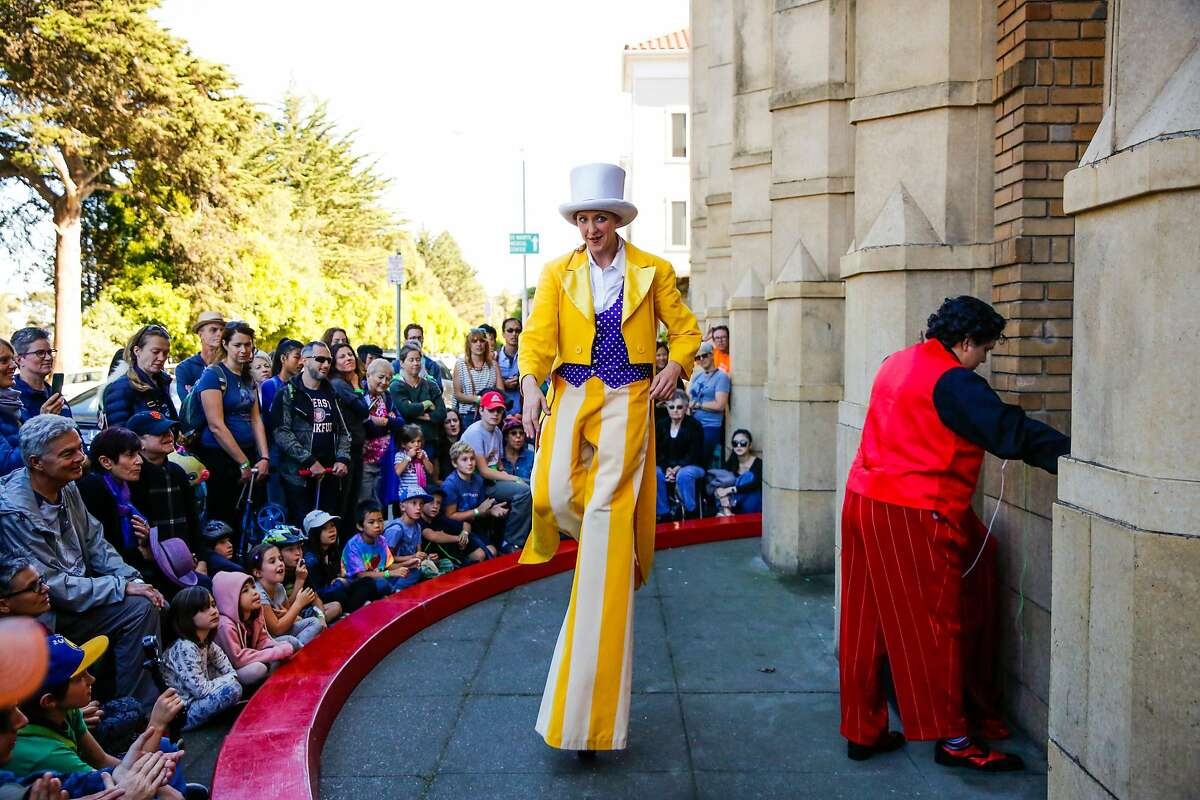 Texas Holly introduces performer Oscar Velarde (right) ahead of his performance during the Epiphany Dance Theater's annual