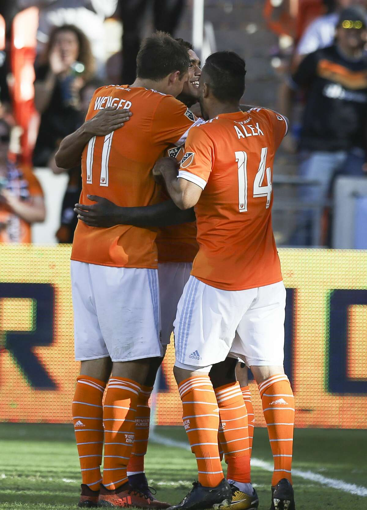 Houston Dynamo players Andrew Wenger (11) and Alex (14) come to celebrate Romell Quioto's (12) goal during the second half of the last MLS regular game at BBVA Compass Stadiujm on Sunday, Oct. 22, 2017, in Houston. The Houston Dynamo defeated the Chicago Fire 3-0. ( Yi-Chin Lee / Houston Chronicle )