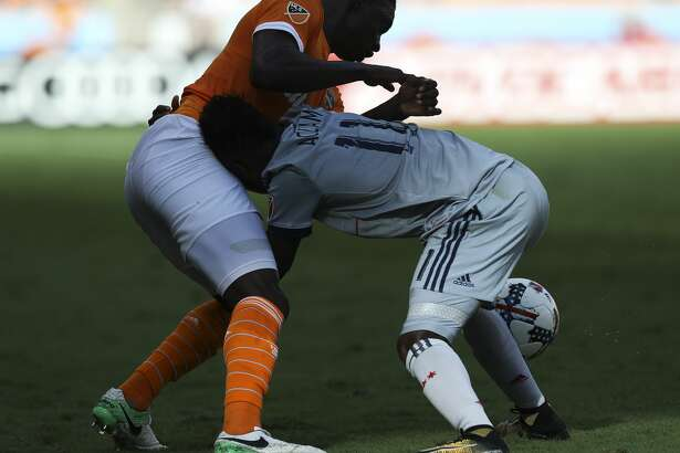 Houston Dynamo defender Jalil Anibaba (2) and Chicago Fire forward David Accam (11) tangle together while battling for control of the ball during the second half of the last MLS regular game at BBVA Compass Stadiujm on Sunday, Oct. 22, 2017, in Houston. The Houston Dynamo defeated the Chicago Fire 3-0. ( Yi-Chin Lee / Houston Chronicle )