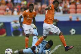 Chicago Fire goalkeeper Richard Sanchez (45) gets the ball away from Houston Dynamo forward Mauro Manotas (19) as Manotas is trying to move toward the box during the second half of the last MLS regular game at BBVA Compass Stadiujm on Sunday, Oct. 22, 2017, in Houston. The Houston Dynamo defeated the Chicago Fire 3-0. ( Yi-Chin Lee / Houston Chronicle )