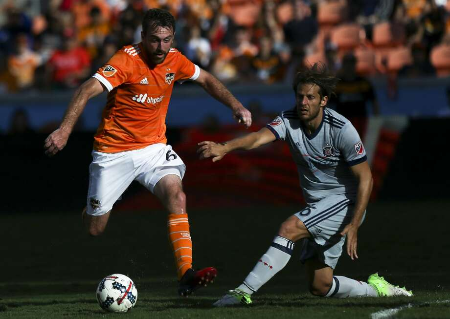 Houston Dynamo midfielder Eric Alexander (6) dribbles while Chicago Fire defender Joao Meira (66) is defensing during the second half of the last MLS regular game at BBVA Compass Stadiujm on Sunday, Oct. 22, 2017, in Houston. The Houston Dynamo defeated the Chicago Fire 3-0. ( Yi-Chin Lee / Houston Chronicle ) Photo: Yi-Chin Lee/Houston Chronicle