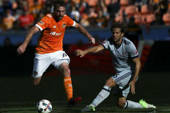 Houston Dynamo midfielder Eric Alexander (6) dribbles while Chicago Fire defender Joao Meira (66) is defensing during the second half of the last MLS regular game at BBVA Compass Stadiujm on Sunday, Oct. 22, 2017, in Houston. The Houston Dynamo defeated the Chicago Fire 3-0. ( Yi-Chin Lee / Houston Chronicle )