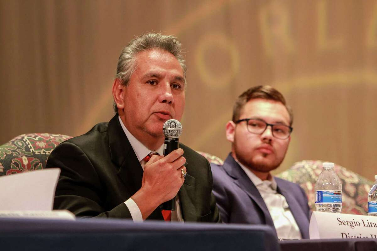 Sergio Lira, left, and Carlos Perrett, candidates for the HISD's Board of Education, during the debate at Lamar High School. (For the Chronicle/Gary Fountain, October 16, 2017)