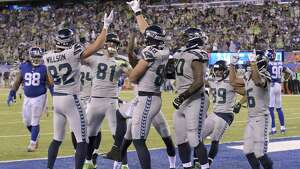 Seattle Seahawks celebrate after a touchdown catch by Jimmy Graham during the second half of an NFL football game against the New York Giants, Sunday, Oct. 22, 2017, in East Rutherford, N.J. (AP Photo/Bill Kostroun)