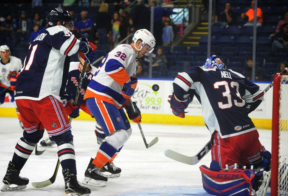Sound Tiger Ross Johnston looks to score in front of Hartford goalie Chris Nell during the first period of their AHL hockey matchup at the Webster Bank Arena in Bridgeport, Conn. on Sunday, October 22, 2017. Photo: Brian A. Pounds / Hearst Connecticut Media / Connecticut Post
