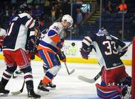 Sound Tiger Ross Johnston looks to score in front of Hartford goalie Chris Nell during the first period of their AHL hockey matchup at the Webster Bank Arena in Bridgeport, Conn. on Sunday, October 22, 2017.