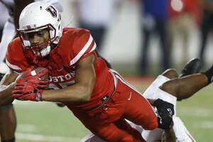 Houston Cougars running back Dillon Birden (25) pushes himself past Tulsa Golden Hurricane safety Jordan Mitchell (13) one of his touchdowns during the second half of an NCAA college football game at TDECU Stadium, Saturday,Oct. 15, 2016 in Pearland.   ( Karen Warren / Houston Chronicle )