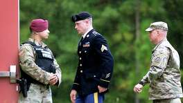 "FORT BRAGG, NC - OCTOBER 16: U.S. Army Sgt. Robert Bowdrie ""Bowe"" Bergdahl, (L) 29 of Hailey, Idaho, is escorted to the Ft. Bragg military courthouse following a lunch recess after pleading guilty to desertion and misbehavior before the enemy on October 16, 2017 in Fort Bragg, North Carolina. Bergdahl could face life in prison stemming from his decision to leave his outpost in 2009, which landed him five years in Taliban captivity. (Photo by Sara D. Davis/Getty Images)"