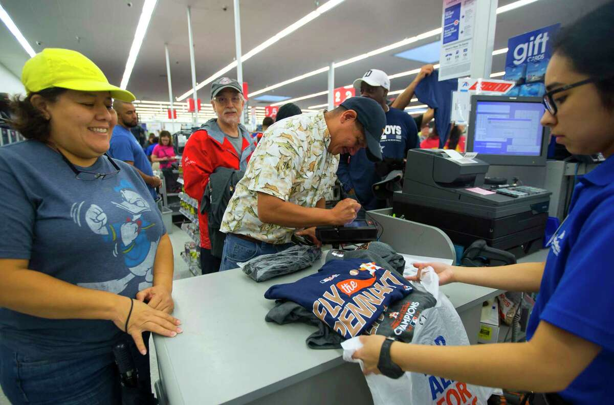 Perla and Don Carreon purchase Astros ALCS champion gear at the Academy Sports + Outdoors location off of the Southwest Freeway on Sunday, Oct. 22, 2017, in Houston.