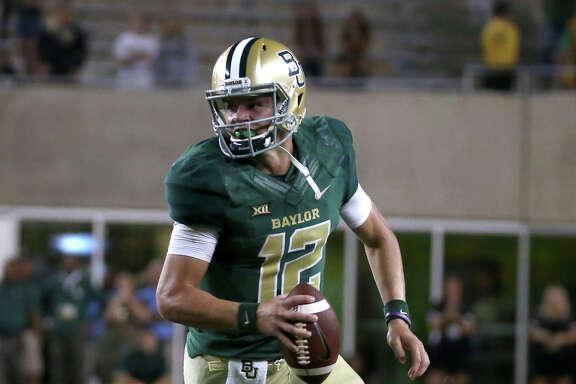 Freshman quarterback Charlie Brewer helped Baylor rally for 23 points in a fourth-quarter comeback that fell just short for the Bears in a 38-36 loss to West Virginia on Saturday night at Waco.