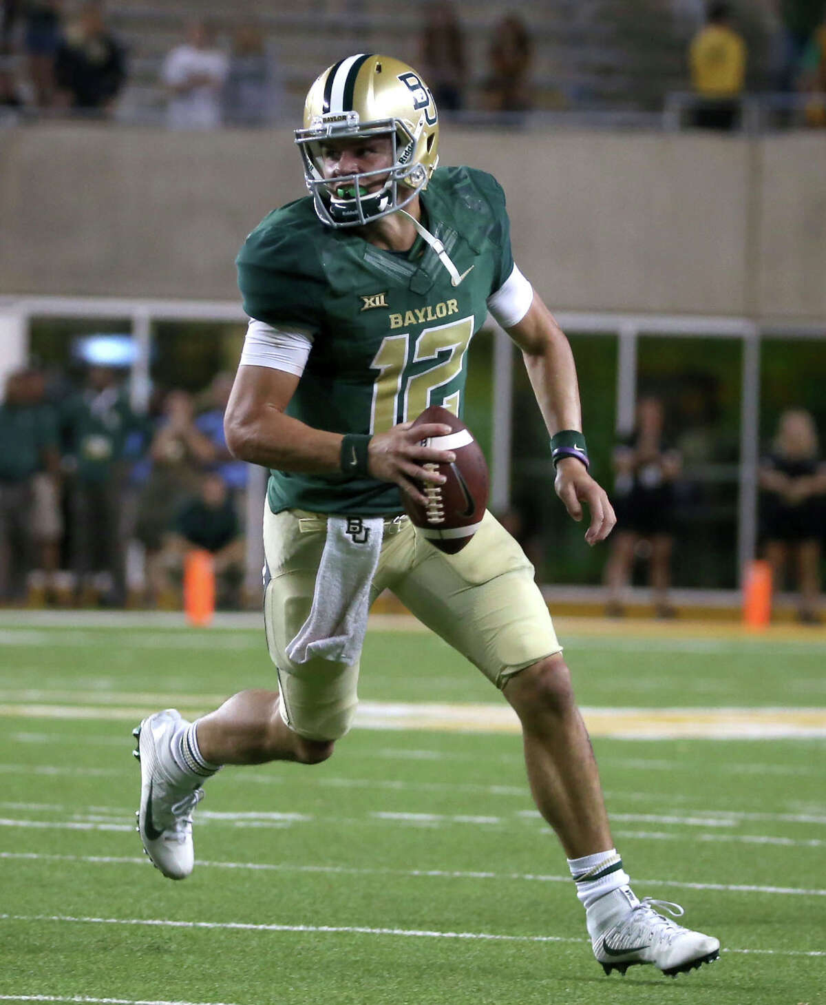 Baylor quarterback Charlie Brewer scrambles against West Virginia during the second half of an NCAA college football game, Saturday, Oct. 21, 2017, in Waco, Texas. West Virginia won 38-36.(AP Photo/Jerry Larson)