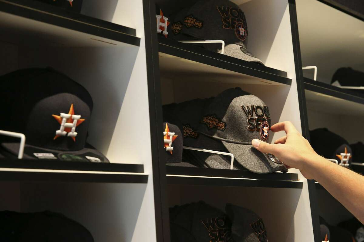 An Astros fan chooses a World Series cap.