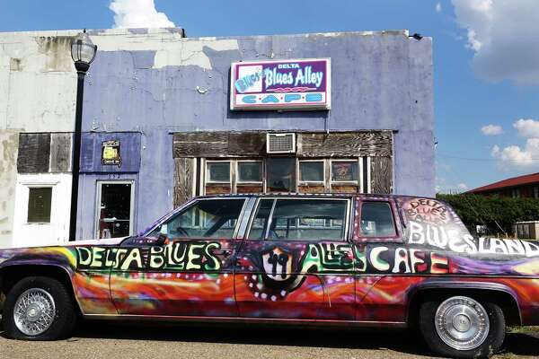 A colorfully decorated car sits outside Delta Blues Alley Cafe in Clarksdale, Miss.