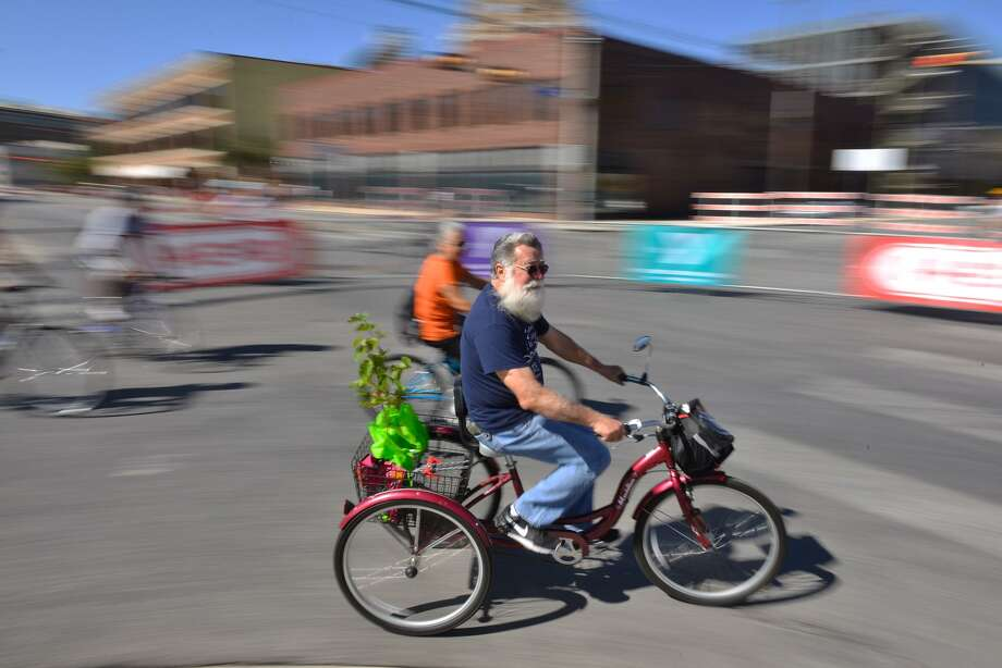 A three-wheeled cyclist turns onto the closed Broadway Street Sunday during the YMCA's semi annual siclovia event. Photo: Robin Jerstad, Freelance / San Antonio Express News