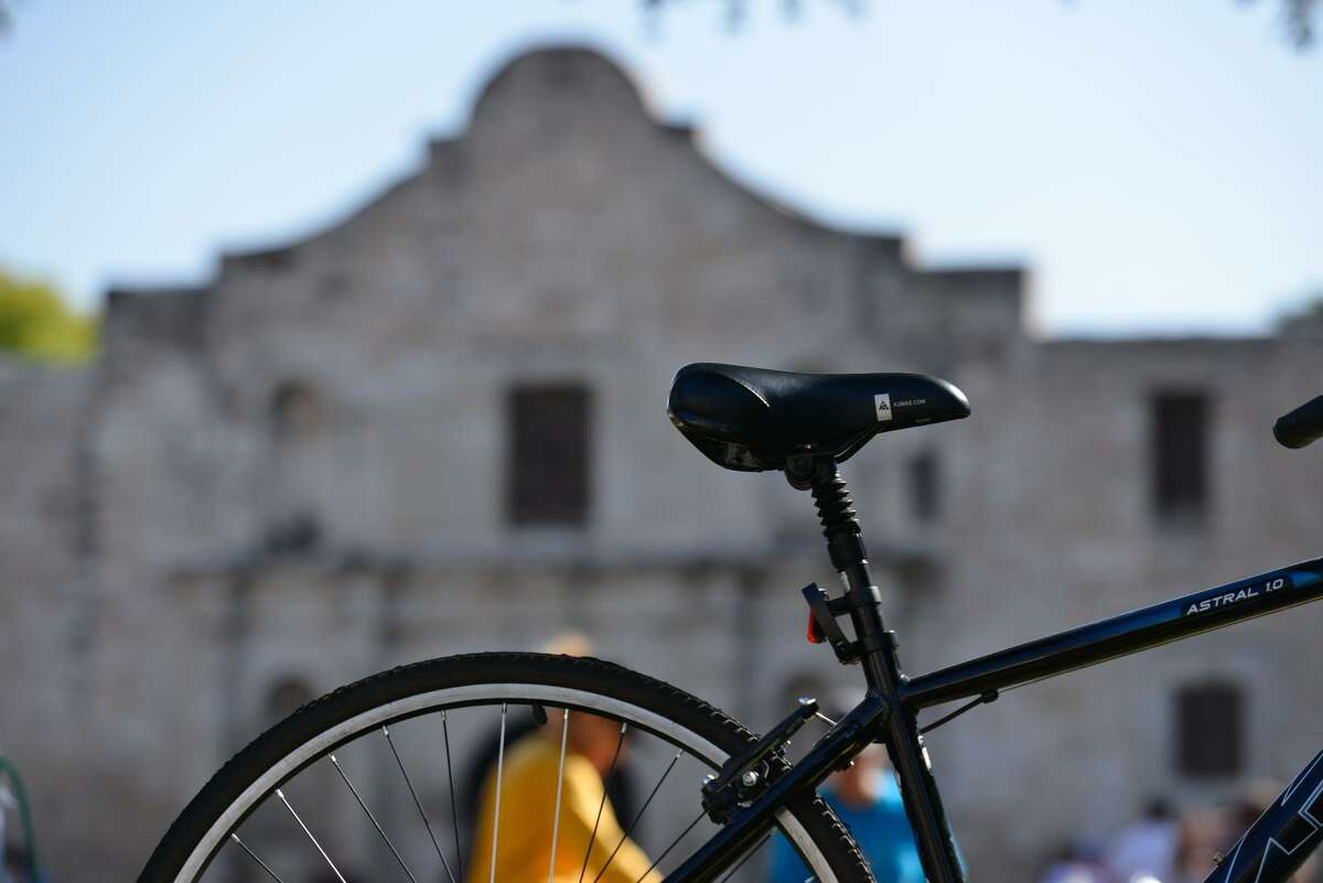 A bicycle waits for its rider in front of the Alamo prior to the start of Sunday's semi-annual Siclovia event.
