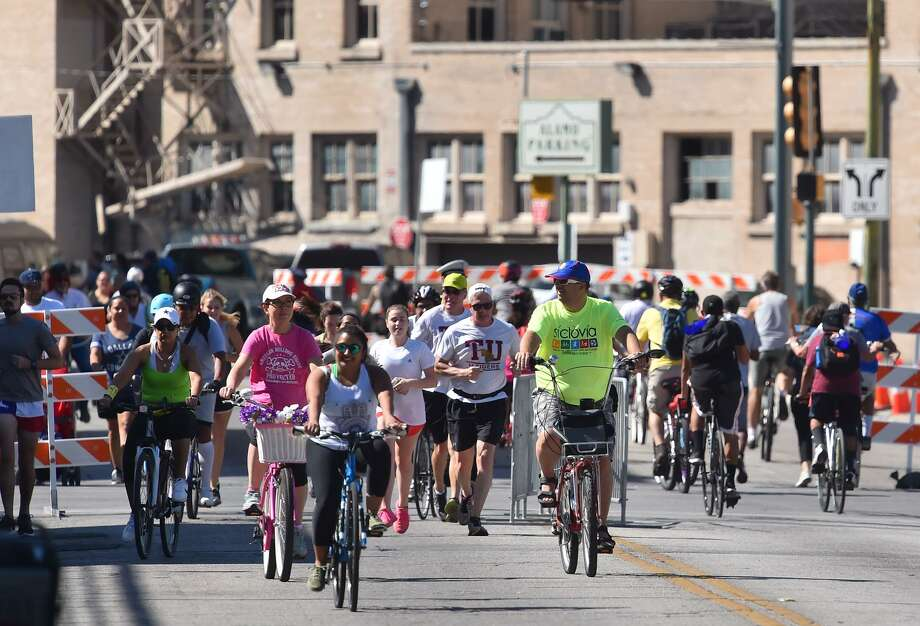 Cyclists and walkers move along a closed Broadway street Sunday during the YMCA's semi-annual Siclovia event. Photo: Robin Jerstad, Freelance / San Antonio Express News / ROBERT JERSTAD