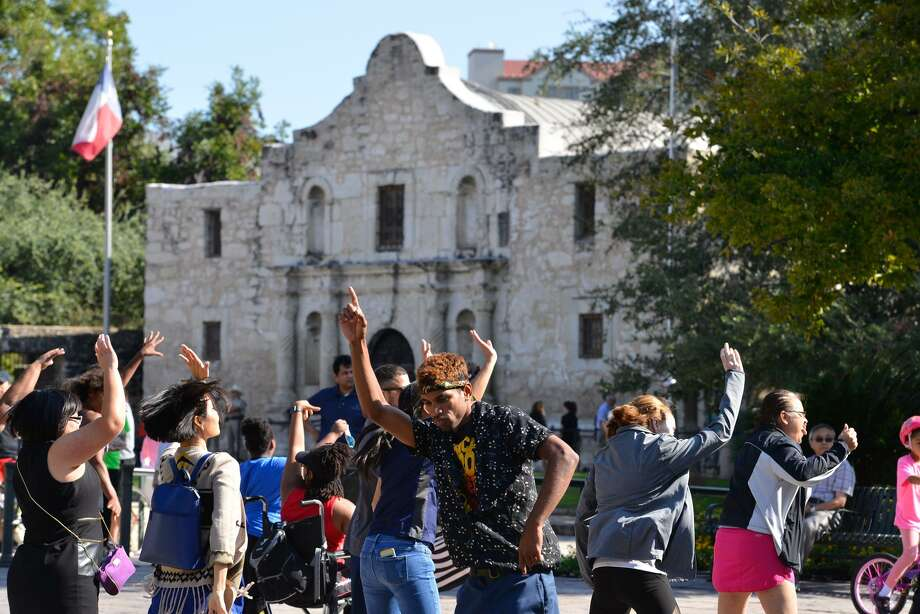 Residents take part in a Zumba class aat Alamo Plaza during a Síclovia. This is sacred ground has been diminished through the years by the city's growth around it. Photo: Robin Jerstad /San Antonio Express News