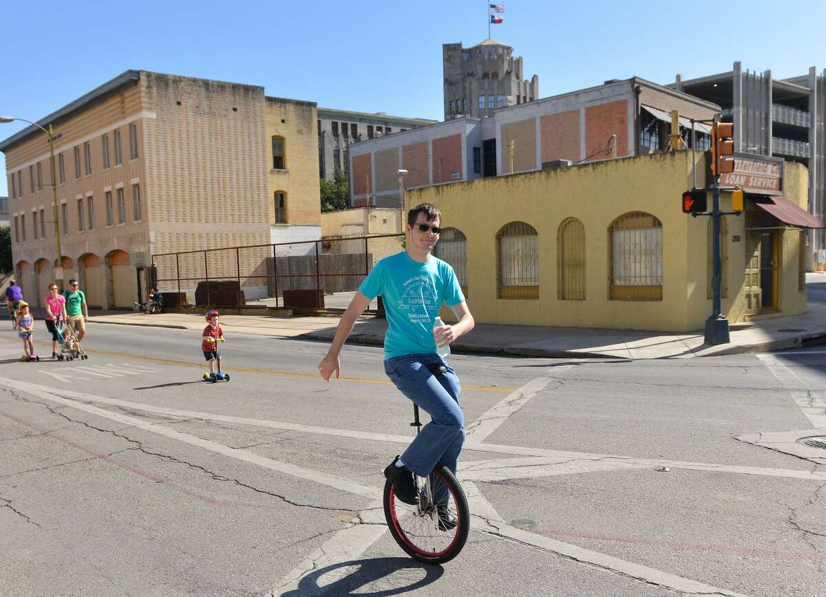 Ryan Zarmbinski rides a unicycle Sunday during the YMCA's semi-annual Siclovia event downtwon.