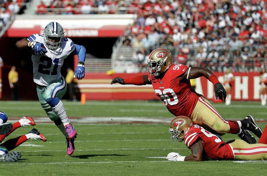 Cowboys running back Ezekiel Elliott (21) puts a catch-me-if-you-can move on 49ers defenders Earl Mitchell (90) and Reuben Foster in the first half of Sunday's game. Elliott rushed 219 yards and three touchdowns. Photo: Marcio Jose Sanchez, STF / Copyright 2017 The Associated Press. All rights reserved.