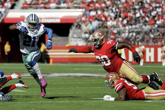 Cowboys running back Ezekiel Elliott (21) puts a catch-me-if-you-can move on 49ers defenders Earl Mitchell (90) and Reuben Foster in the first half of Sunday's game. Elliott rushed 219 yards and three touchdowns.