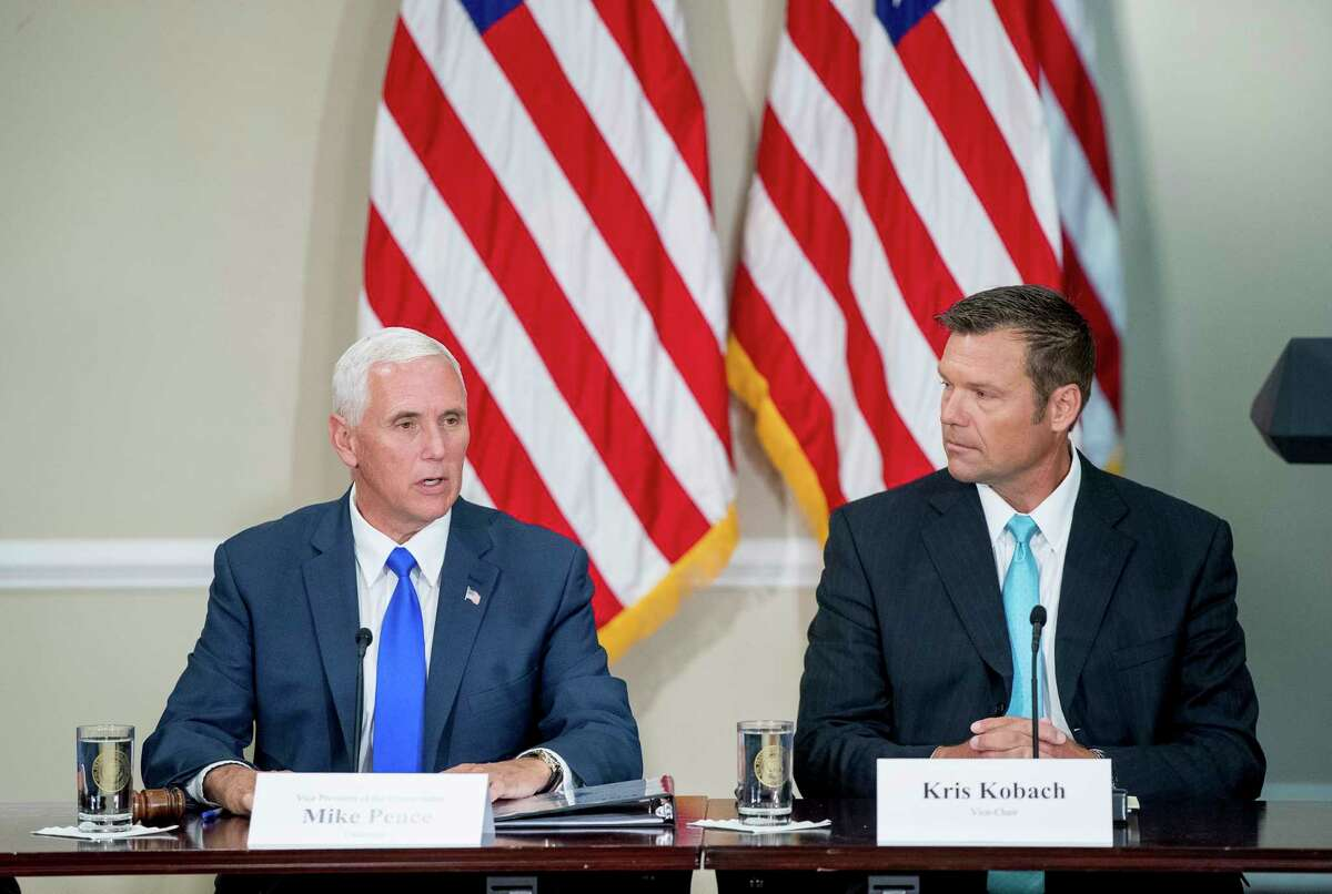 FILE - In this Wednesday, July 19, 2017 file photo, Vice President Mike Pence, left, accompanied by Vice-Chair Kansas Secretary of State Kris Kobach, right, speaks during the first meeting of the Presidential Advisory Commission on Election Integrity at the Eisenhower Executive Office Building on the White House complex in Washington. The information coming out of President Donald TrumpÂ?'s commission to investigate voter fraud has frustrated not only reporters and senators but now even members of the commission. (AP Photo/Andrew Harnik, File)
