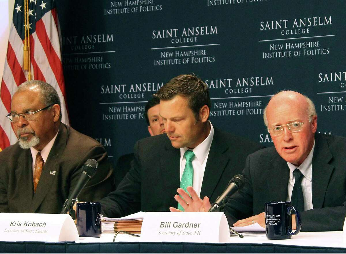 FILE - In this Tuesday, Sept. 12, 2017 file photo, New Hampshire Secretary of State Bill Gardner, right, introduces one of the speakers at a meeting of the Presidential Advisory Commission on Election Integrity in Manchester, N.H. Kansas Secretary of State Kris Kobach, center, and former Ohio Secretary of State Ken Blackwell, left, also attend. The information coming out of President Donald TrumpÂ?'s commission to investigate voter fraud has frustrated not only reporters and senators but now even members of the commission. (AP Photo/Holly Ramer, File)