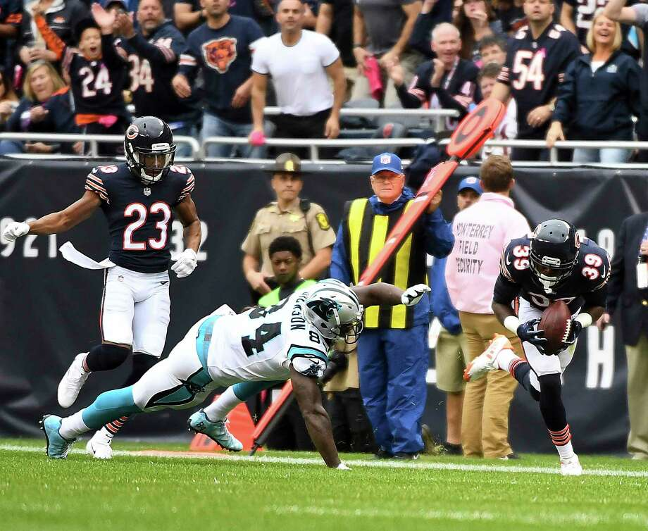 Chicago safety Eddie Jackson scoops up a fumble and returns it 75 yards for a touchdown against Carolina on Sunday. Jackson also had a 76-yard interception return for a score - the first NFL player to score multiple defensive TDs of 75 yards or more in a game. Photo: Rick West, MBI / © Daily Herald 2017