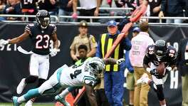 Chicago safety Eddie Jackson scoops up a fumble and returns it 75 yards for a touchdown against Carolina on Sunday. Jackson also had a 76-yard interception return for a score - the first NFL player to score multiple defensive TDs of 75 yards or more in a game.