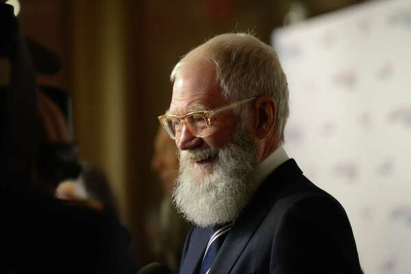 David Letterman, the recipient of the 20th annual Mark Twain Prize for American Humor, is interviewed on the red carpet at the Kennedy Center on Sunday.