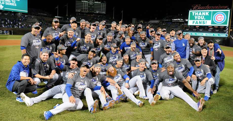 The Los Angeles Dodgers celebrate after an 11-1 series-clinching win against the Chicago Cubs in Game 5 of the National League Championship Series at Wrigley Field in Chicago on Thursday, Oct. 19, 2017. (Wally Skalij/Los Angeles Times/TNS) Photo: Wally Skalij/TNS