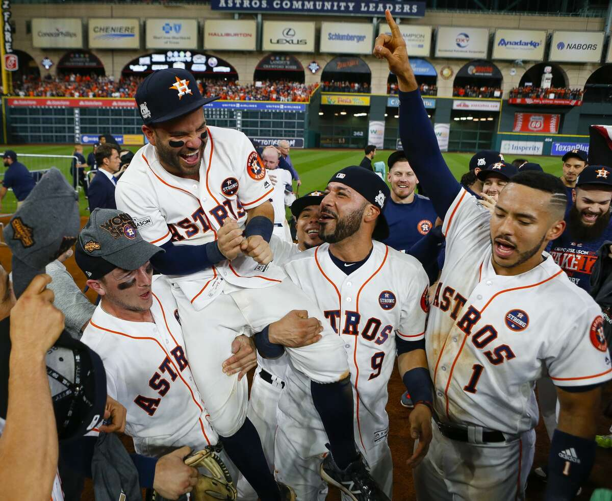 Alex Bregman and Marwin Gonzalez hold Jose Altuve on their shoulders while celebrating the Astros 4-0 win over the Yankees in Game 7 of the ALCS at Minute Maid Park on Saturday, Oct. 21, 2017, in Houston. ( Brett Coomer / Houston Chronicle )