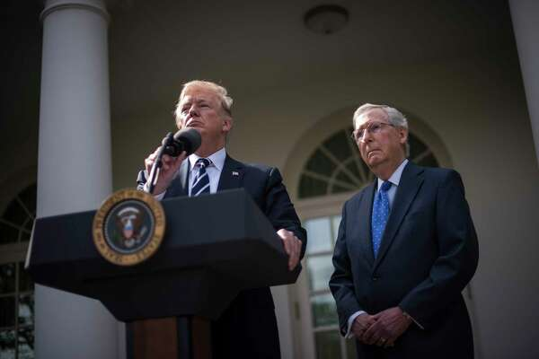 WASHINGTON, DC - OCTOBER 16: President Donald Trump speaks with Senate Majority Leader Mitch McConnell of Ky., in the Rose Garden after their meeting at the White House in Washington, DC on Monday, Oct. 16, 2017. (Photo by Jabin Botsford/The Washington Post)