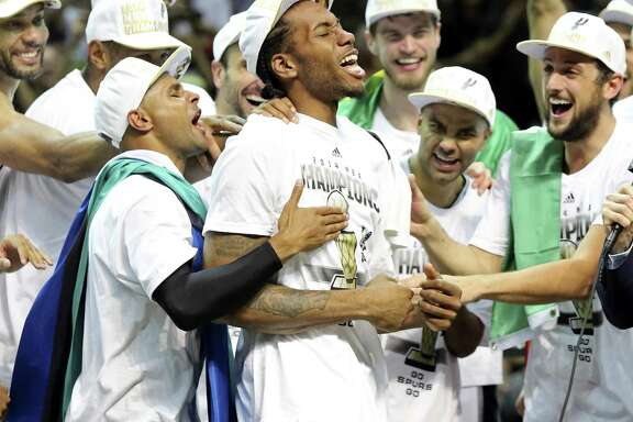 Kawhi Leonard celebrates the 2014 NBA title with his teammates.