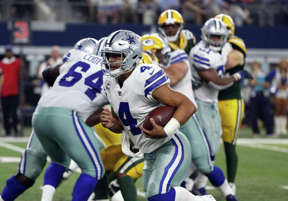 Cowboys quarterback Dak Prescott escapes the pocket to scramble for yards against the Green Bay Packers on Oct. 8 at AT&T Stadium in Arlington. Photo: Michael Ainsworth /Associated Press / FR171389
