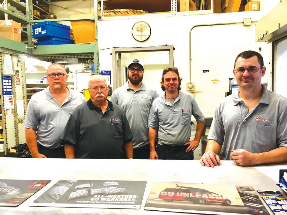 At the parts department at Cassens. From left: Brian Schmidt, Dennis Harbry, Josh Hasameer, Dave Wilkinson and Tim Kinkel. Photo: Steve Horrell