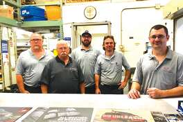 At the parts department at Cassens. From left: Brian Schmidt, Dennis Harbry, Josh Hasameer, Dave Wilkinson and Tim Kinkel.