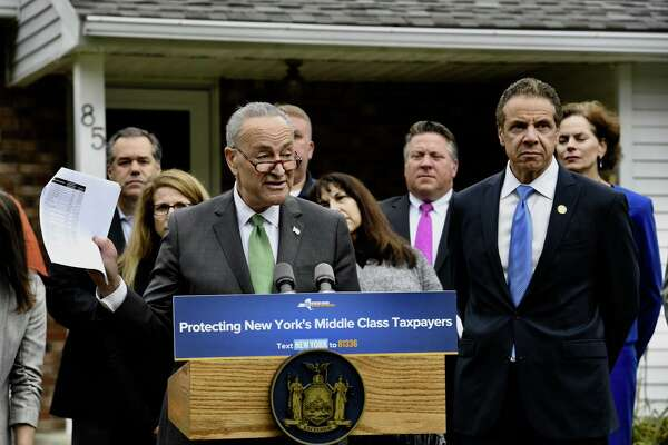 Senate Minority Leader Charles Schumer and Gov. Andrew Cuomo speak at a news conference they called to decry a Republican-led effort to end the federal tax deductions for state and local taxes. The measure is part of the tax overhaul being considered by Congress.