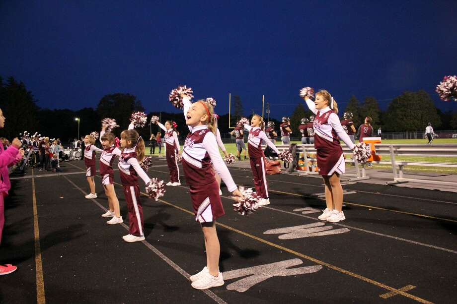 The Cass City Youth Cheer squad and the Cass City High School Band were part of the sideline and halftime show action Friday night when the Cass City Red Hawks beat the Caro Tigers in the last home football game of the season. Photo: Brenda Battel/Huron Daily Tribune