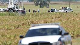 Investigators work the scene of a hot air balloon crash, Sunday July 31, 2016, that killed 16 people near Maxwell, Texas in Caldwell County.