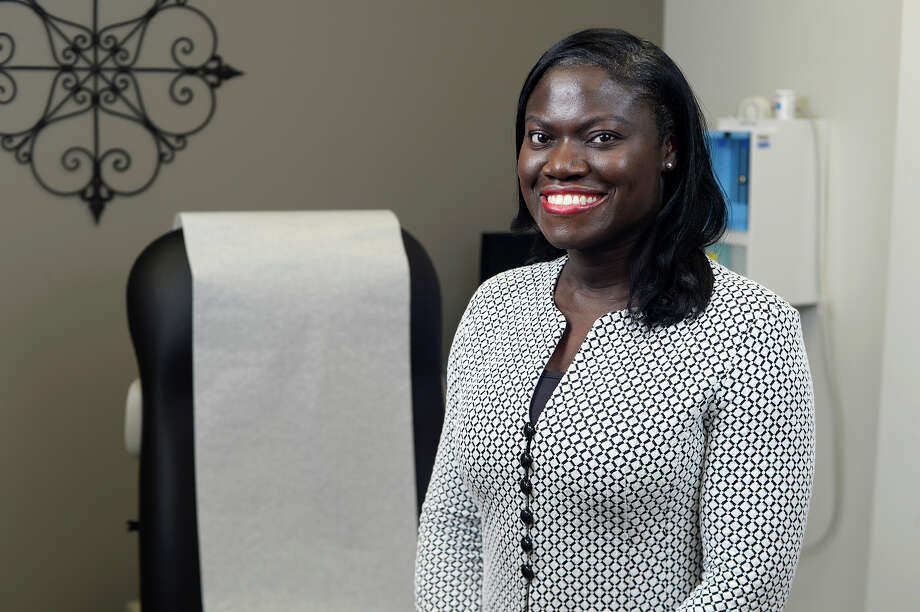 Dr. Chisa Echendu, a radiation oncologist at Altus Cancer Center, was diagnosed with stage three breast cancer in 2006 while studying medicine. The diagnosis altered her career path from doing lab research toward caring for patients.  Photo taken Monday 10/2/17 Ryan Pelham/The Enterprise Photo: Ryan Pelham / ©2017 The Beaumont Enterprise/Ryan Pelham