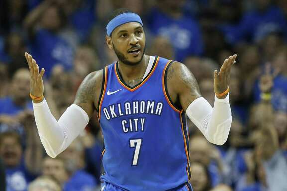 Thunder forward Carmelo Anthony gestures after hitting a 3-pointer in the second quarter against the Knicks in Oklahoma City on Oct. 19.