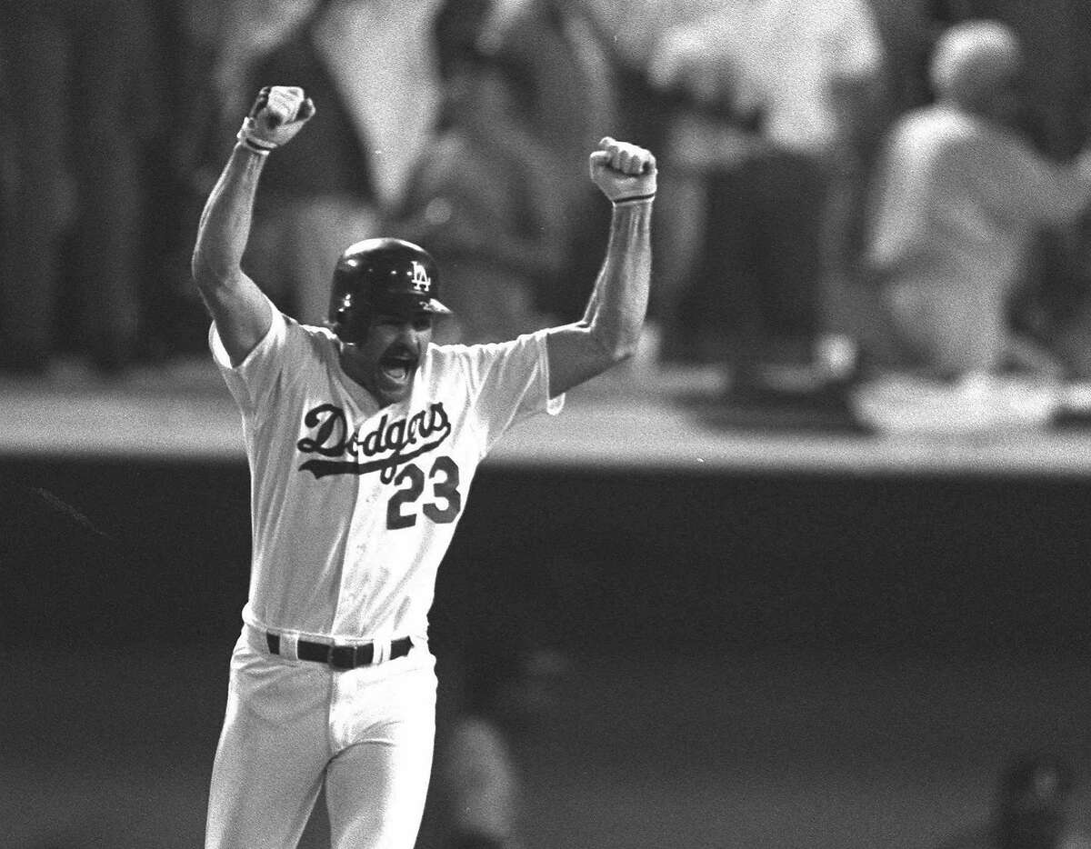 Los Angeles Dodgers Kirk Gibson reacts to his game winning two-run homer in the bottom of the ninth inning Oct. 15, 1988 as he rounds the bases at Dodger Stadium in Los Angeles. The homer gave the Dodgers a 5-4 win over the Oakland A's in the first game of the World Series. (AP Photo/John Swart)