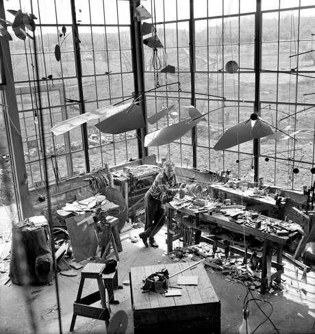 Calder with Mobile in his Roxbury studio, 1941  © 2017 Calder Foundation, New York / Artists Rights Society (ARS), Photo: Herbert Matter