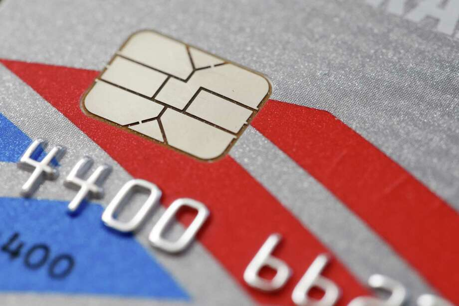 The Connecticut Better Business Bureau is encouraging consumers to watch for wear and tear to CHIP-enabled credit cards, as repetitive use can cause the CHIP to fall off, leaving the card's owner vulnerable to fradulent purchases made in their name.(AP Photo/Matt Rourke, File) Photo: Matt Rourke / Associated Press / Copyright 2016 The Associated Press. All rights reserved. This material may not be published, broadcast, rewritten or redistribu