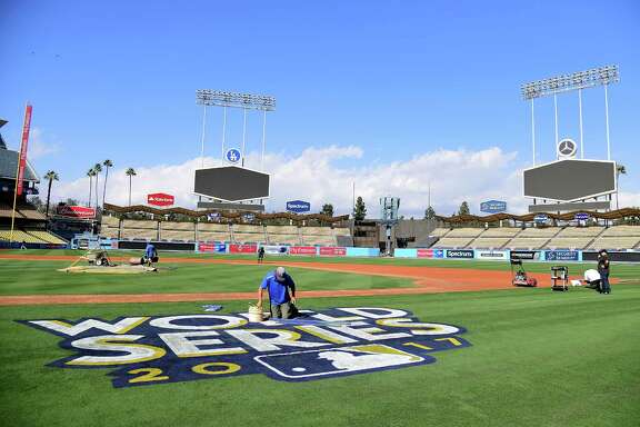 LOS ANGELES, CA - OCTOBER 20:  The World Series logo is painted on to the field in preparation for game one and two at Dodger Stadium on October 20, 2017 in Los Angeles, California.