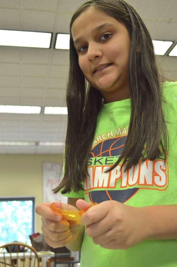"Avni Mittal, 10, of Westport, handles her creation at The Westport Library's MakerSpace ""Slime Time"" activity, Sunday, Oct. 22, 2017, in Westport, Conn. Photo: Jarret Liotta / For Hearst Connecticut Media / Westport News Freelance"